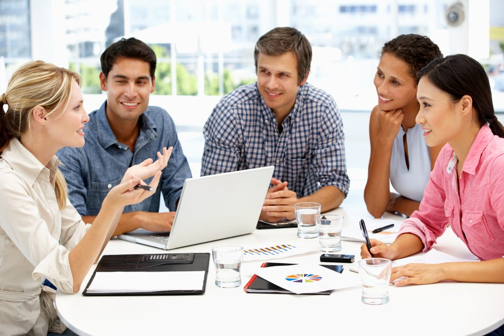 Image of mixed group in business meeting